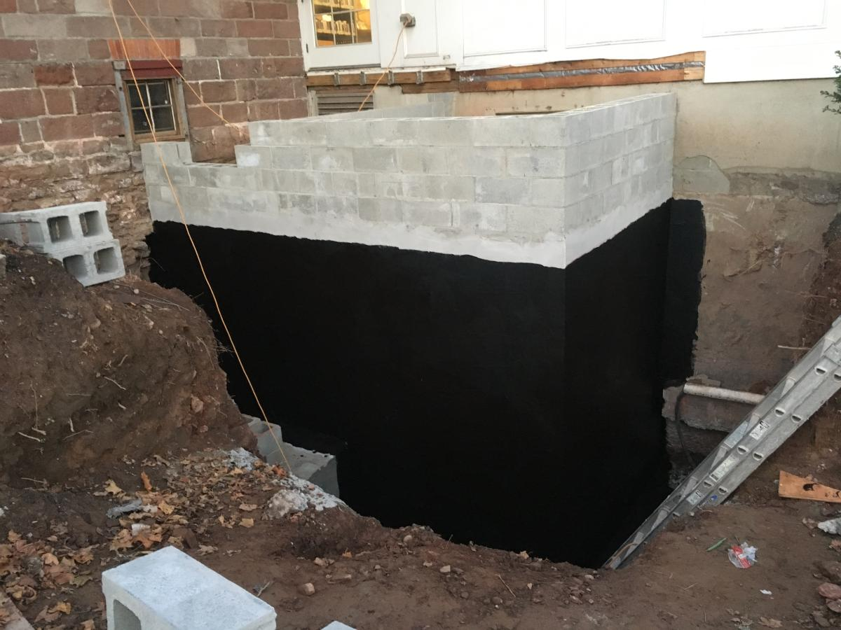 Base of elevator shaft showing waterproofing